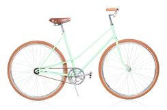 Stylish green female bike with brown wheels on white Stock Photography