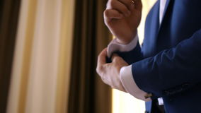 Stylish groom in blue luxury suit wearing cufflinks close up 2 stock video footage