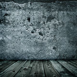 Stylish grunge wall texture and wooden floor. Indoors Stock Images
