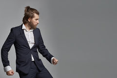 Stylish guy with beard wearing suit Royalty Free Stock Photo