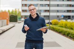Stylish guy connected on internet with tablet and mobile phone i Stock Photo
