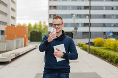Stylish guy connected on internet with tablet and mobile phone i Royalty Free Stock Photo