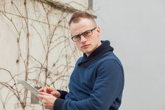 Stylish guy connected on internet with tablet in town Stock Image