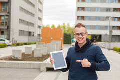 Stylish guy connected on internet with tablet in town. He is hap Royalty Free Stock Photography