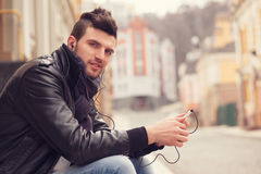 Stylish guy with smartphone. In the city Royalty Free Stock Image