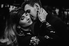 Stylish gypsy couple in love passionately dancing in evening cit. Y street. women and men kissing, romantic french atmospheric moment. passion love mood. black royalty free stock photos