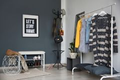 Stylish hallway interior with clothes rack. And coat stand royalty free stock photography