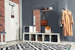 Stylish hallway interior with mirror and stand. Stylish hallway interior with mirror and hanger stand stock photo