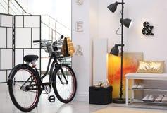 Stylish hallway interior with modern bicycle stock image