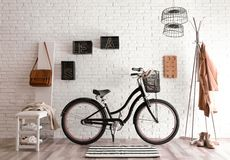 Stylish hallway interior with modern bicycle. Hipster design royalty free stock image