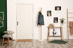 Stylish hallway interior with shoe storage bench, hanger stand stock images