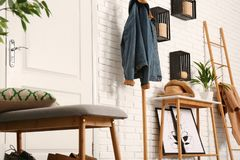 Stylish hallway interior with shoe storage bench and table royalty free stock photos