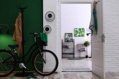 Stylish hallway with modern bicycle. Idea for interior decor stock photo
