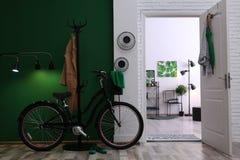 Stylish hallway with modern bicycle stock image