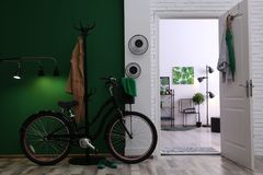 Stylish hallway with modern bicycle. Idea for interior decor stock image