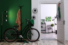 Hallway with modern bicycle. Idea for interior decor. Stylish hallway with modern bicycle. Idea for interior decor royalty free stock photography