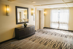Stylish hallway in modern residence with rich furniture and carpet Royalty Free Stock Images