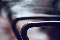 Stylish handlebar of a metallic chair  photograph Stock Images