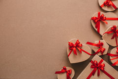 Stylish handmade gifts with red ribbons. Royalty Free Stock Photo
