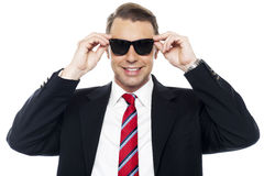 Stylish handsome businessman wearing shades Stock Photography