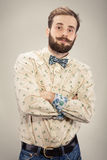 Stylish handsome man with beard and moustache. Portrait male with bow tie Royalty Free Stock Photo