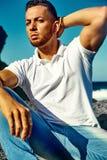 Stylish handsome man model  behind sky Royalty Free Stock Image
