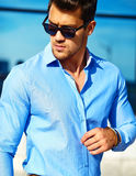 Stylish handsome man model in the street Royalty Free Stock Images