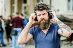 Stylish and handsome music lover. business ebook online. Ebook holds much that is important to me. Face the music. Hipster fashion style. New technologies royalty free stock photos