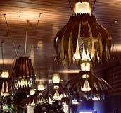 Stylish hanging interior lights of a food court isolated unique photo. A beautiful hanging food court lights isolated unique stock photograph royalty free stock photos