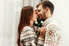 Stylish happy family gently hugging at christmas tree. joyful co stock photography
