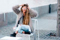 Stylish happy girl in the coat Royalty Free Stock Images