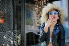 Stylish happy girl with sunglasses. Afro curly hairstyle cute spring Stock Photo