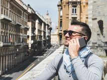 Stylish, happy man with a smartphone. Leisure, travel, positive stock photography