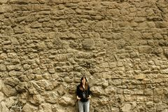 Stylish happy woman with analog film camera  on background of ci. Ty old wall, space for text Royalty Free Stock Photos