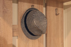 Stylish hat hanging on a hanger royalty free stock photography