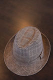 Stylish Hat On Table. A stylish dress hat on a table Royalty Free Stock Photography