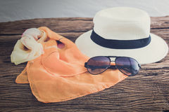 Stylish hat woman sunglasses and tablet fashion scarf over woode Stock Photos