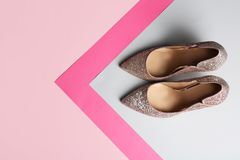 Stylish high heel shoes on color background, top view. Space for text royalty free stock photos