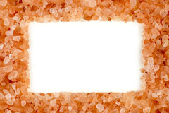 Stylish himalayan rock salt frame with aerial white copyspace Stock Images