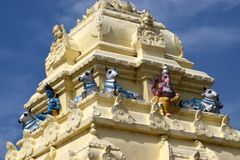 Hindu religious temple top - stock photograph. Religious temple with blue sky abstract background stock photograph Royalty Free Stock Image