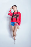 Stylish hipster asian girl in american patriotic outfit looking at camera isolated on grey Royalty Free Stock Images