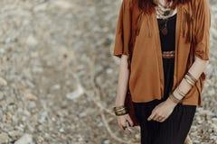 Stylish hipster boho traveler woman look. gypsy girl in fringe j Royalty Free Stock Photo