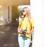 Stylish hipster cool girl in sunglasses outdoors Stock Photos