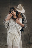 Stylish hipster couple gently hugging. man in hat sensual touchi. Stylish hipster couple gently hugging. men in hat sensual touching boho women in knitted Royalty Free Stock Images