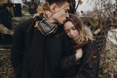 Stylish hipster couple hugging gently in autumn park. fashionabl Royalty Free Stock Image