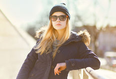 Stylish hipster girl posing in the city a warm day Stock Image
