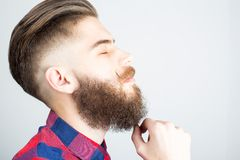 Stylish hipster guy. Portait of a hipster guy with beard and mustache royalty free stock photo