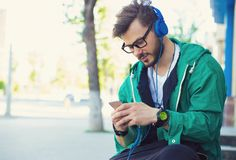 Stylish hipster with headphones�and phone Stock Images