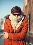Stylish hipster man freezes in the city Royalty Free Stock Images