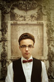 Stylish hipster man wearing glasses and tweed hat, being confide Royalty Free Stock Photos